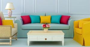 blue-livingroom-blue-sofa-colorful-pillows_573x300